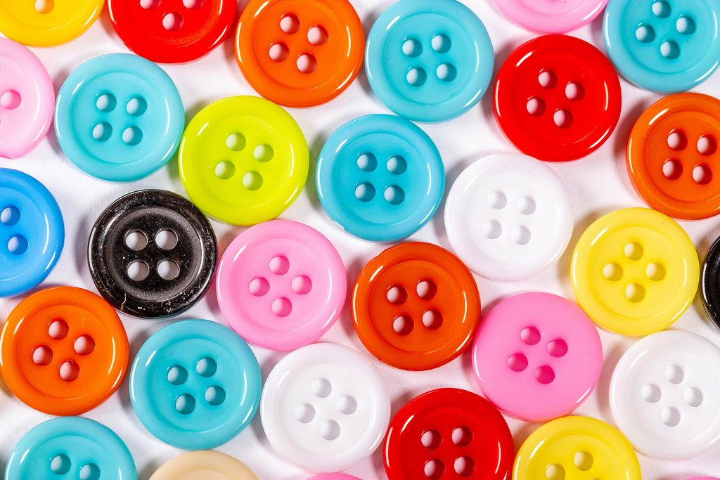 Buttons of different colors on white background
