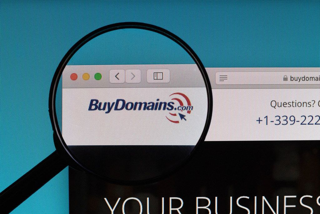 BuyDomains.com logo under magnifying glass