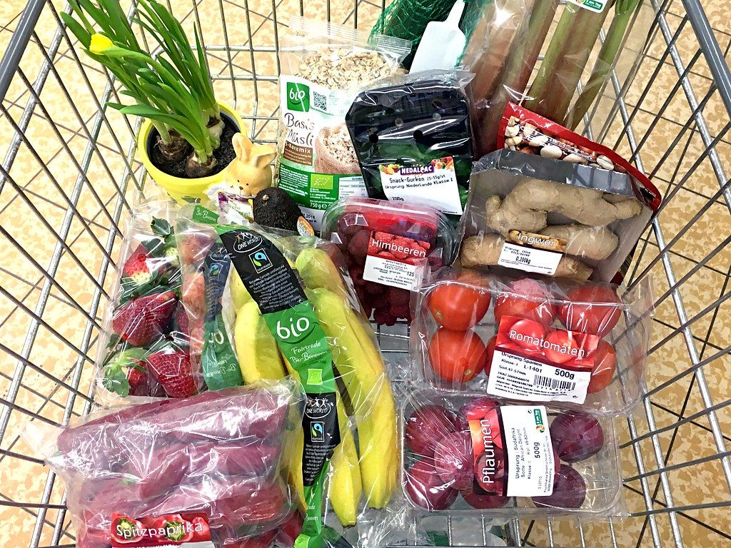 Buying fruit and vegetables in plastic packaging at the supermarket