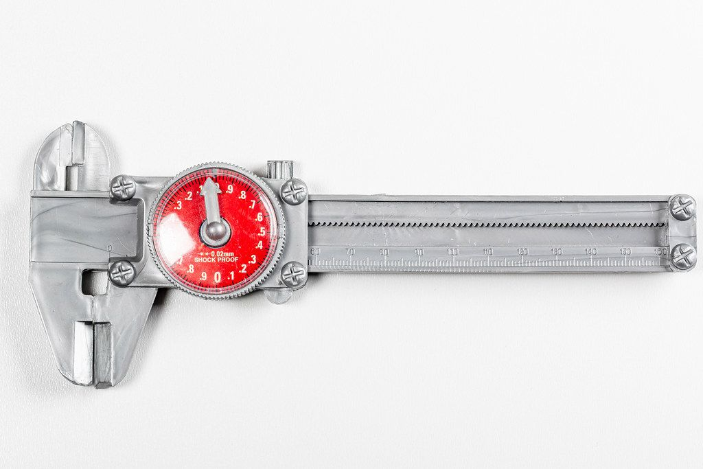 Caliper on a white background, top view