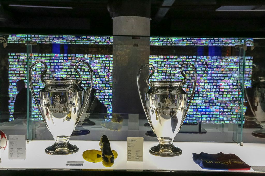Camp Nou Museum in Spain exhibits trophies from FC Barcelona's winning champions league soccer game of 2015 in Berlin in glass display cabinet