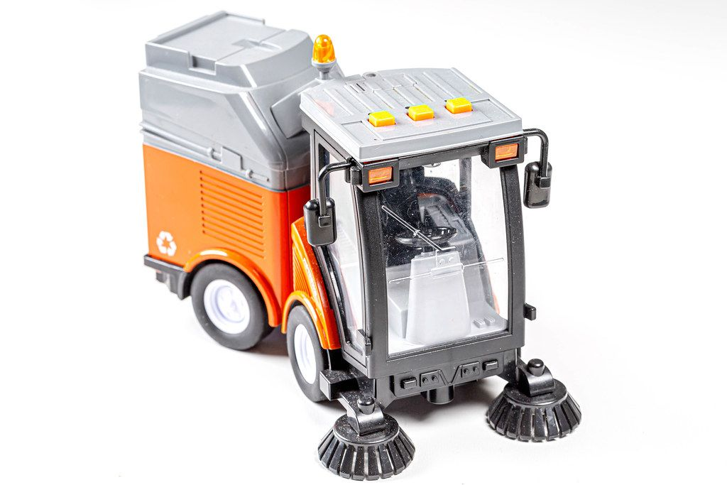 Car for cleaning roads and sidewalks on a white background. Children's toy (Flip 2019)