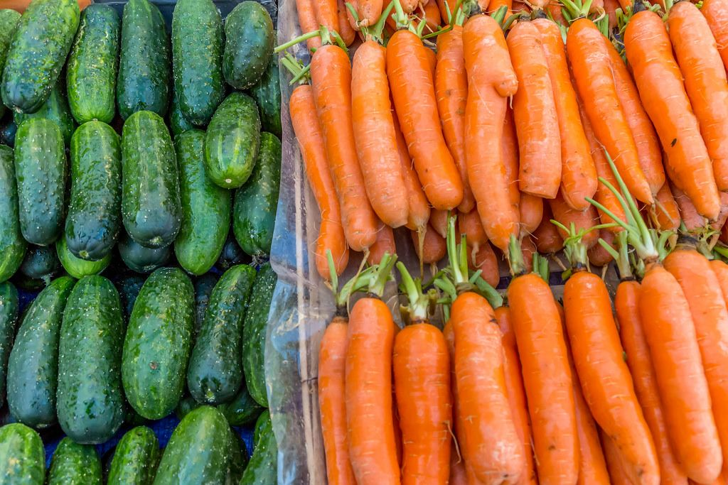 Carrots and cucumbers on marketplace