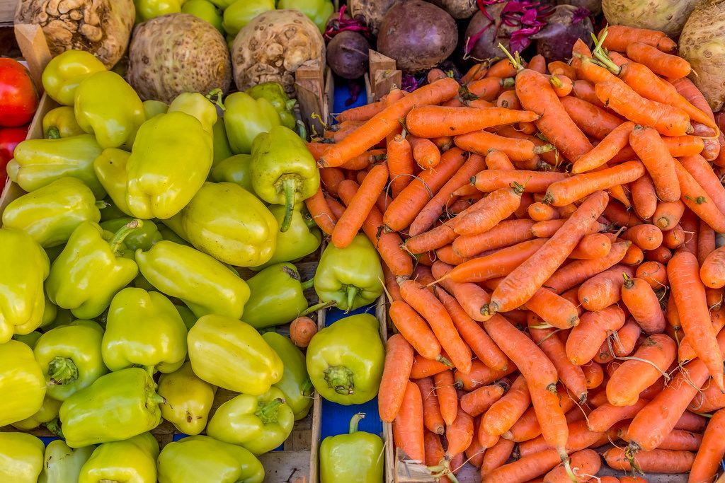 Carrots and paprikas on marketplace