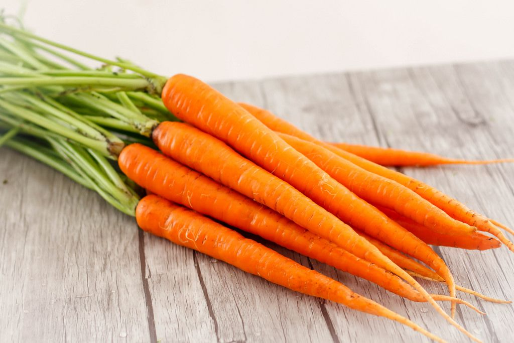 Carrots Close-up on a Wooden Background