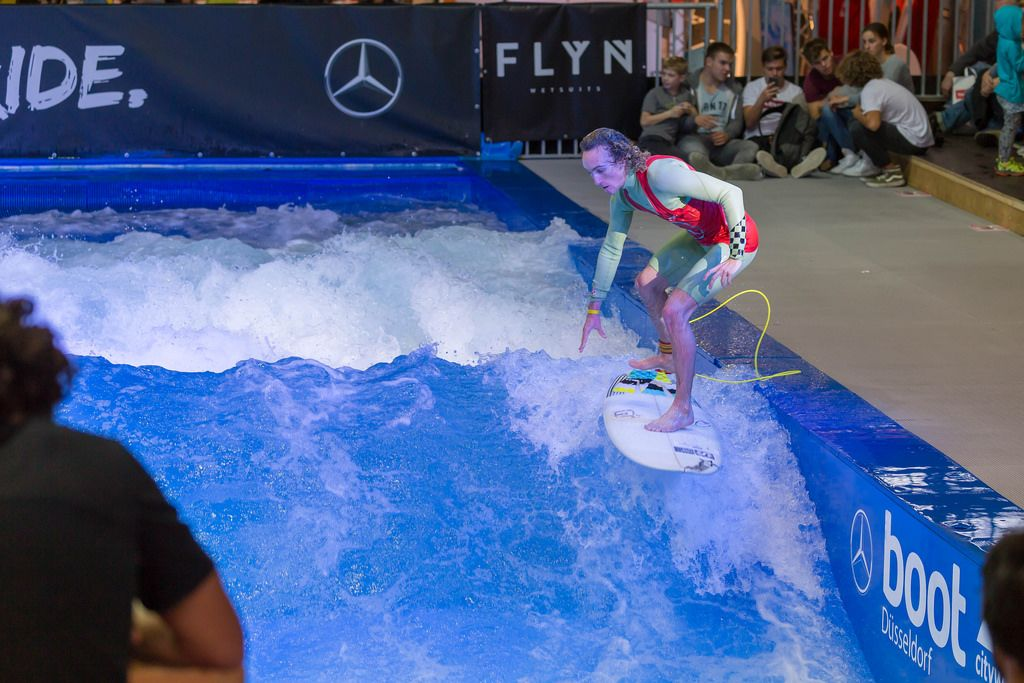 Catching the wave on a Citywave surf machine at fair Boot Düsseldorf 2018