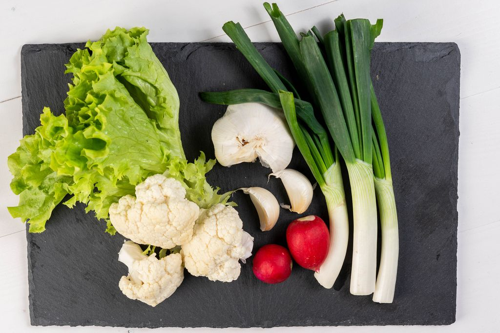 Cauliflower Young Onions Garlic Red Radishes and Lettuce on the black tray (Flip 2019)