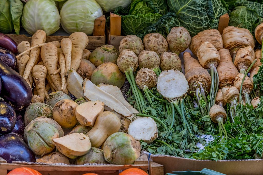 Celery, eggplants and parsley on marketplace
