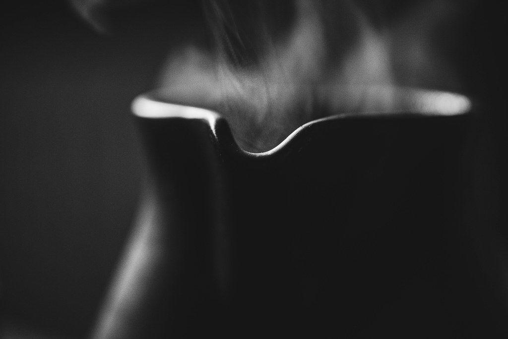 Ceramic Tepot Closeup And Hot Tea Smoke