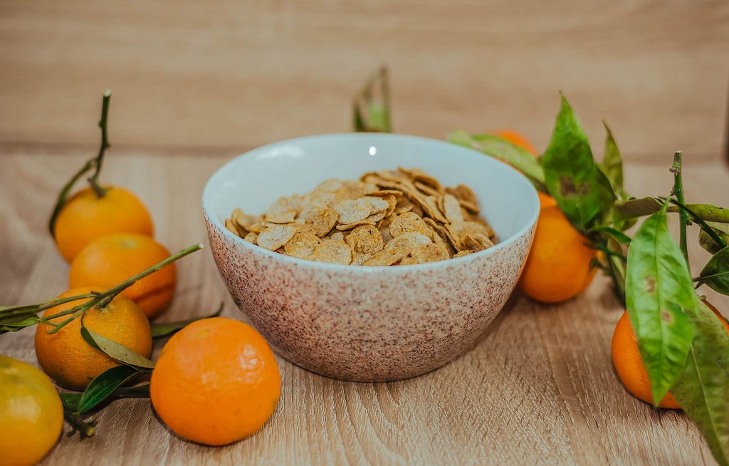 Cereal In A Bowl And Tangerines