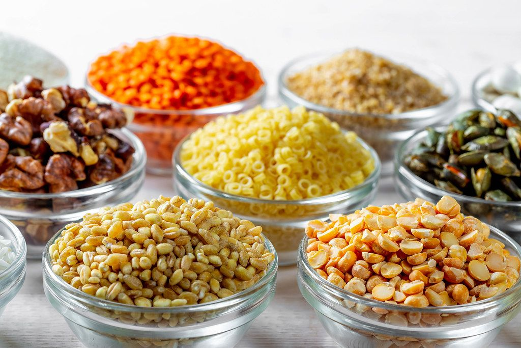 Cereals, seeds and nuts in glass bowls close-up