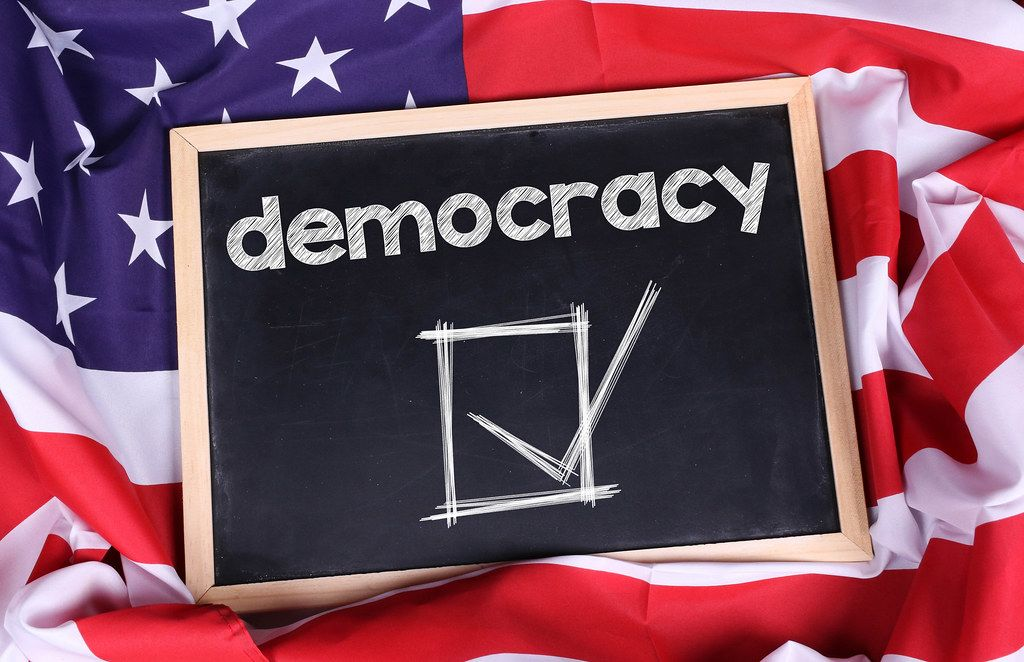Chalkboard with Democracy text on American flag