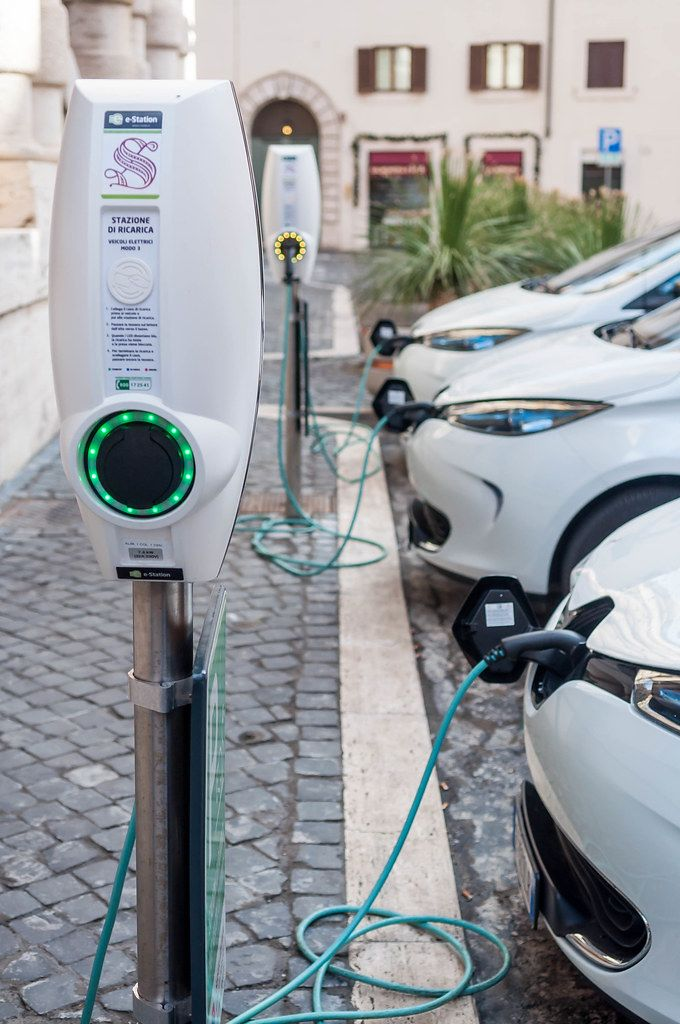 Charging electric cars at e-stations in Rome, Italy