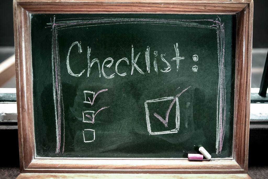 Checklist written on a chalkboard