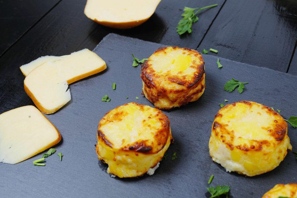 Cheesy potatoes on black background