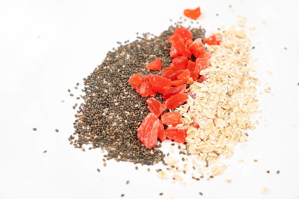 Chia Seeds, Dried Papaya and Oatmeal above white background