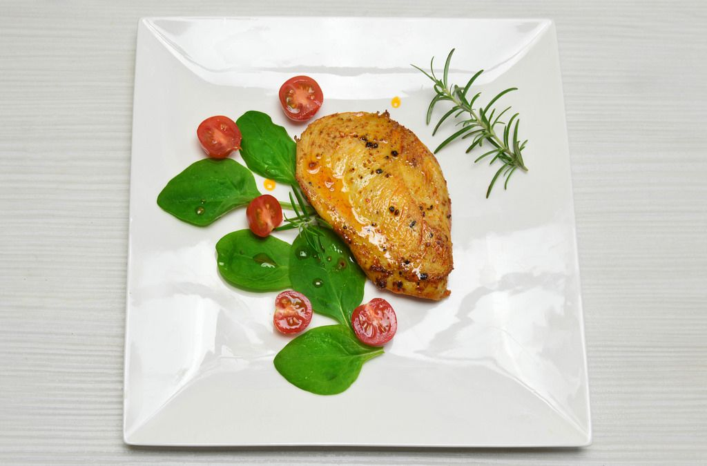 Chicken schnitzel with cherry tomatoes and spinach