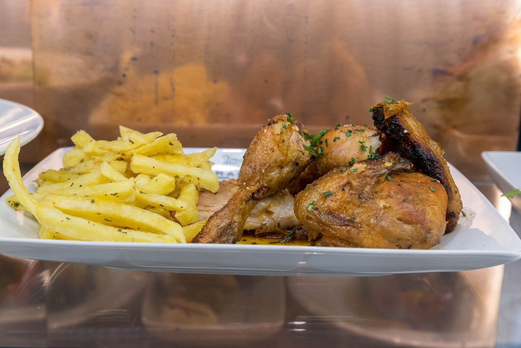 Chicken wings with french fries in portuguese style
