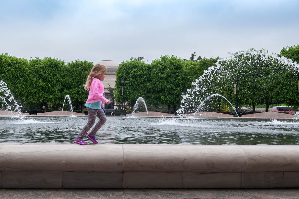 Child playing at fountains