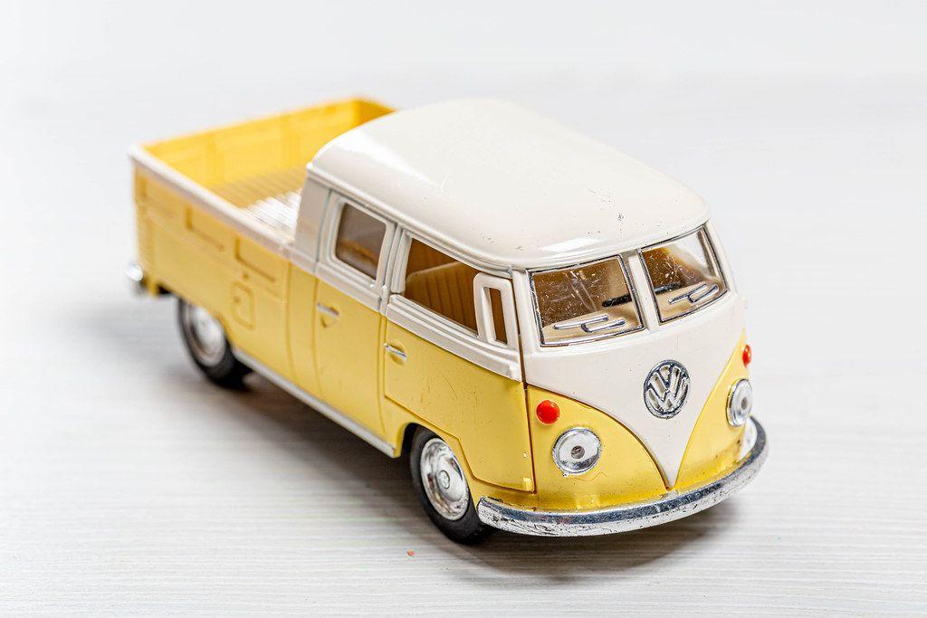 Children's metal model Volkswagen pickup truck on white background