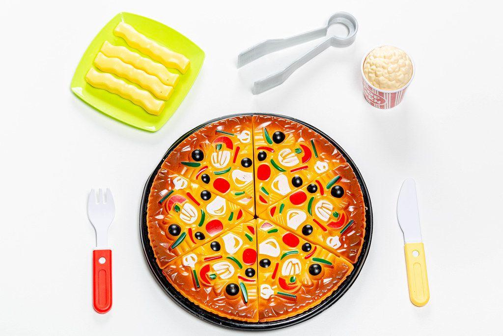 Children's plastic food toy set on white background