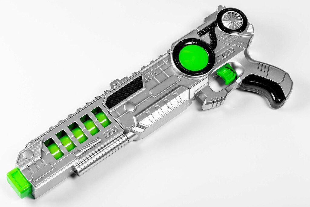 Children's plastic toy gun on white background