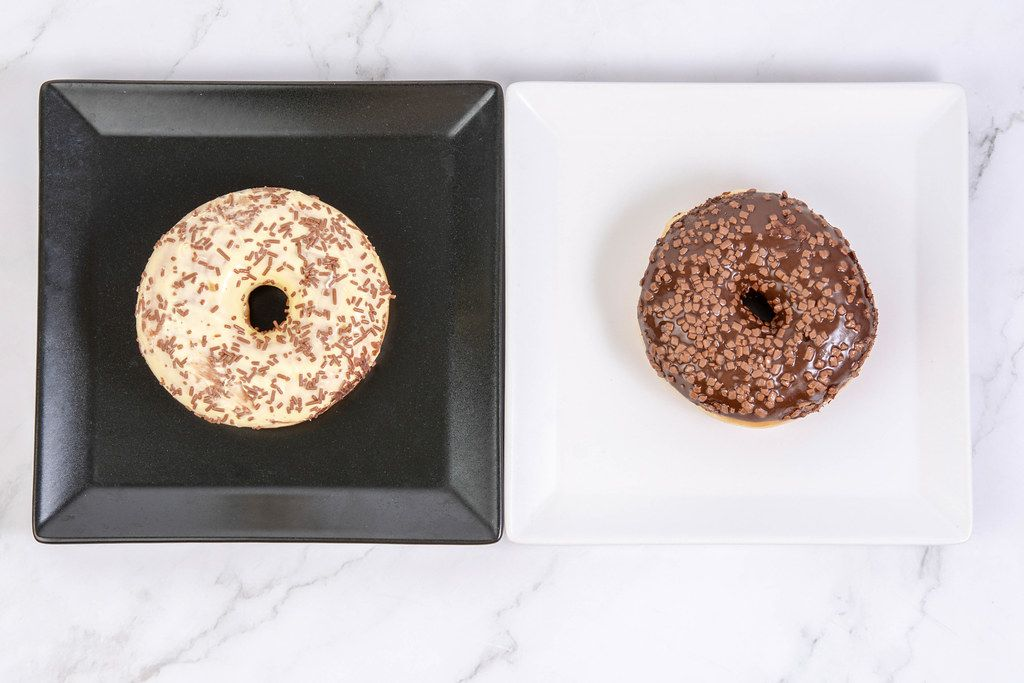 Chocolate and Vanilla Donuts on the square plates