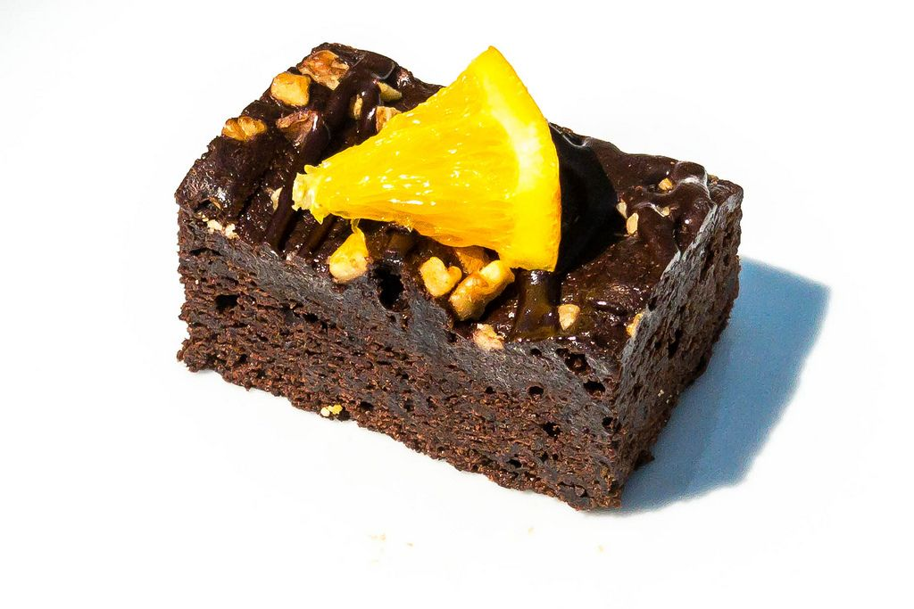Chocolate brownie with an orange slice on top