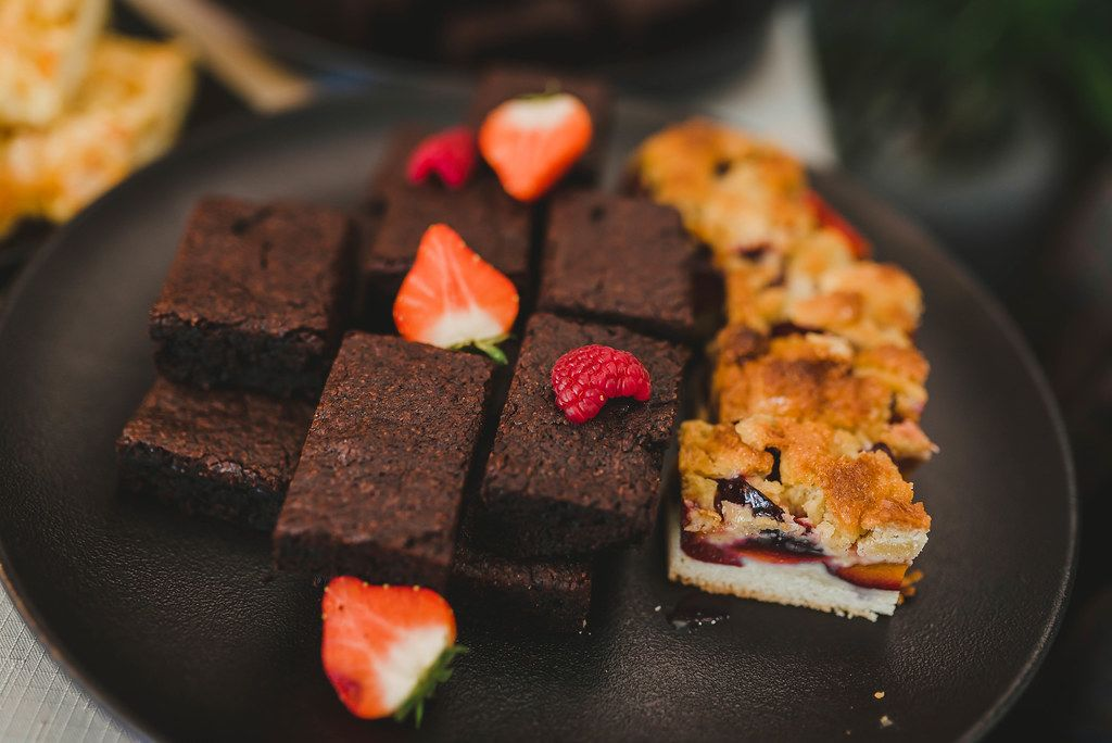 Chocolate Brownie With Berries On Black Plate