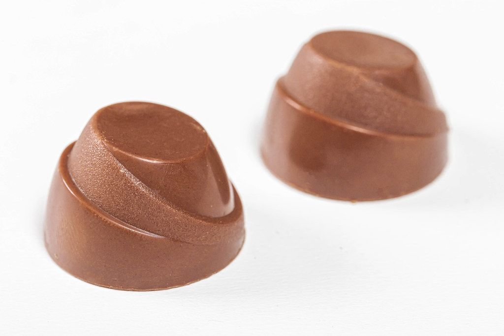 Chocolate candies on white background close up (Flip 2019)