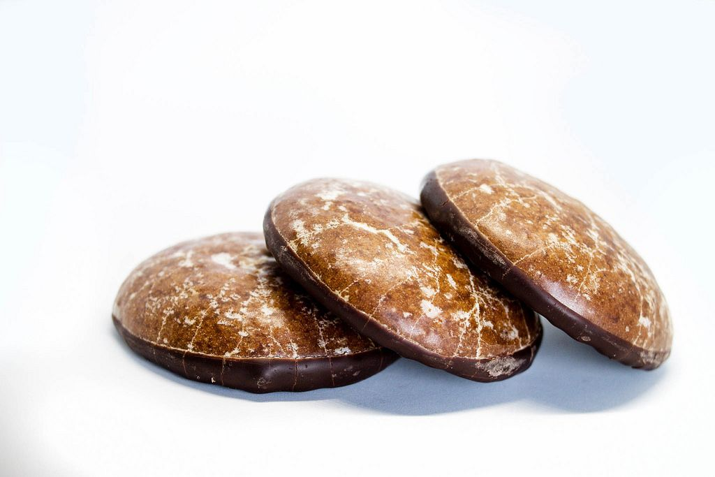 Chocolate ginger cookies on white background
