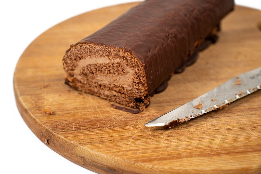 Chocolate Roll cake sliced on the wooden board