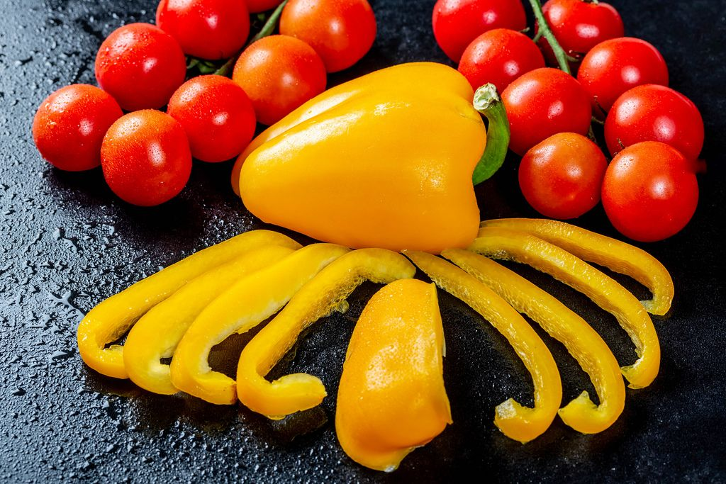Chopped yellow pepper with branches of cherry tomatoes