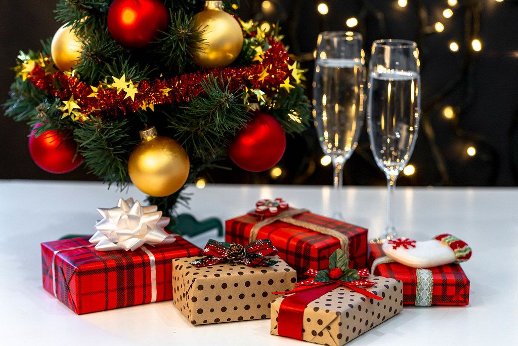 Christmas background with Christmas tree, gifts and glasses of champagne (Flip 2019)