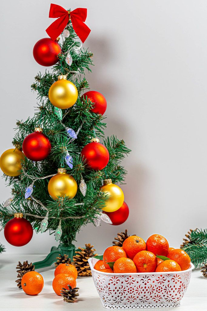 Christmas background with decorated Christmas tree and tangerines (Flip 2019)