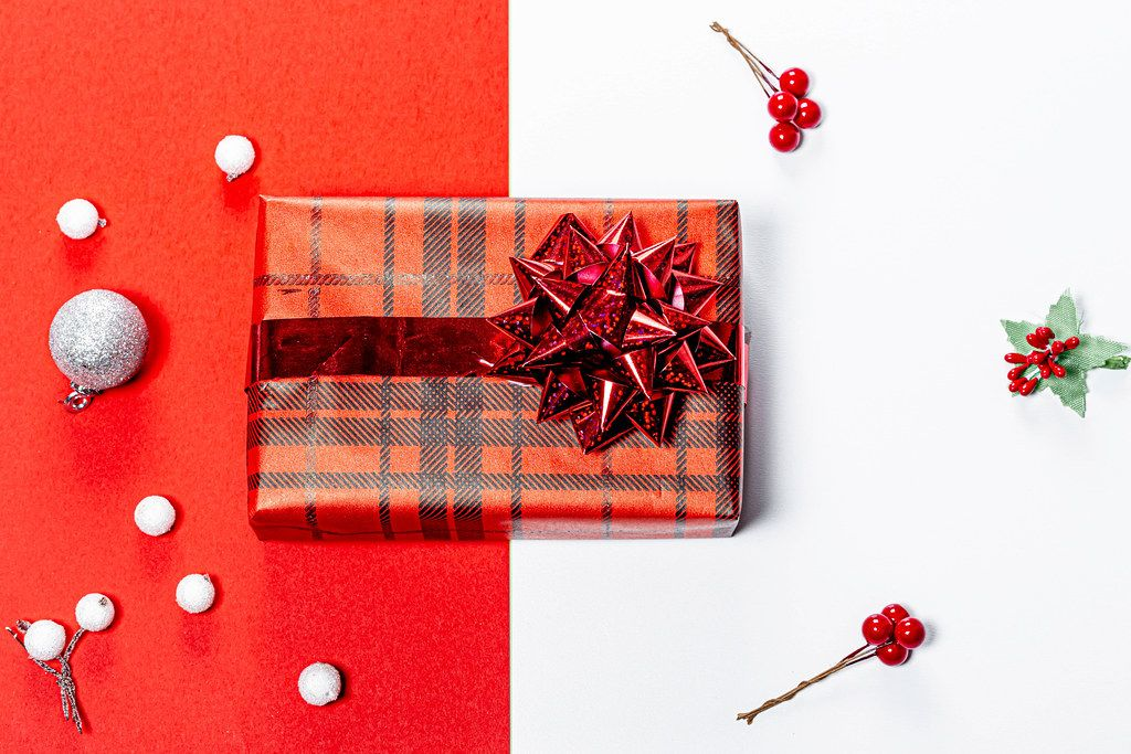 Christmas red and white background with Packed gift. Top view (Flip 2019)