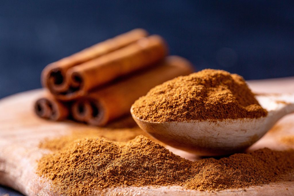 Cinnamon ground in a wooden spoon