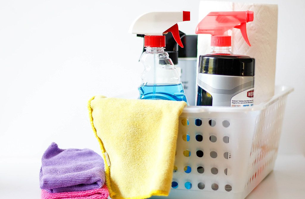 Cleaning supplies in a box symbolising household cleaning