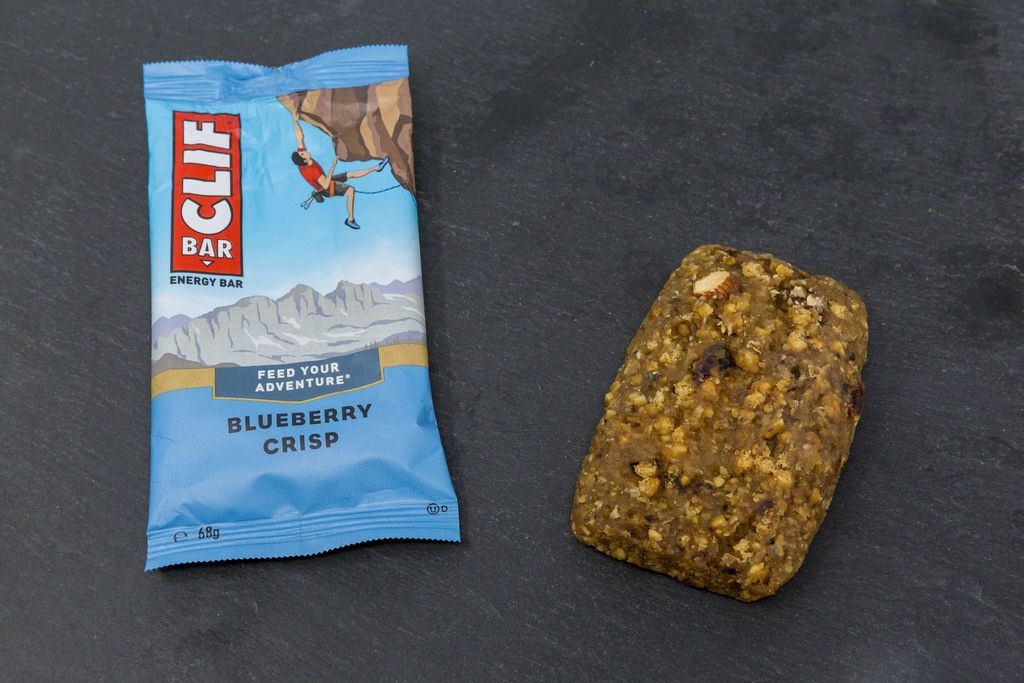 Clif Bar - Energy Bar with Blueberry Crisp Flavor and Packaging on black plate