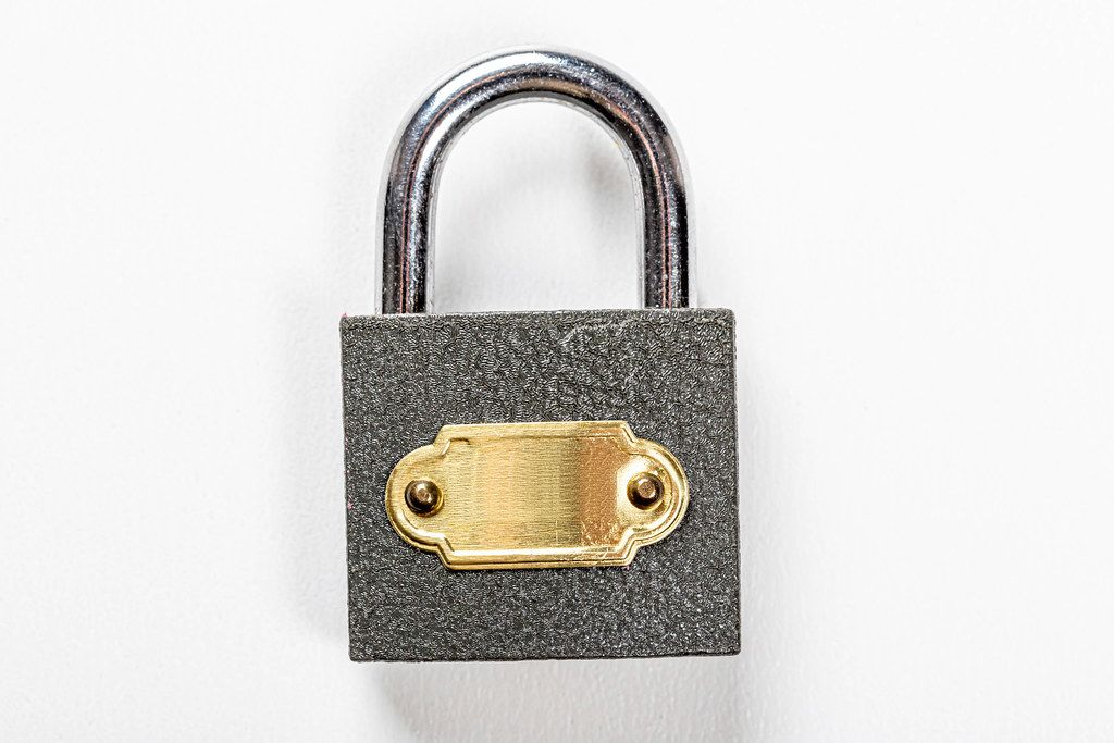 Close padlock on white background