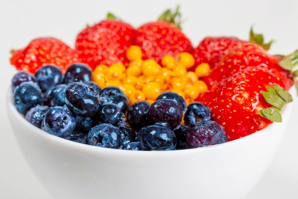 Close-up, a bowl of oatmeal and fresh berries