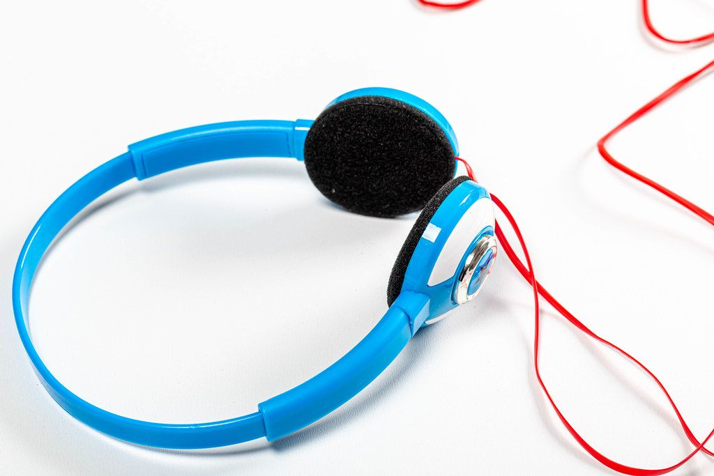 Close up blue headphones with red cords