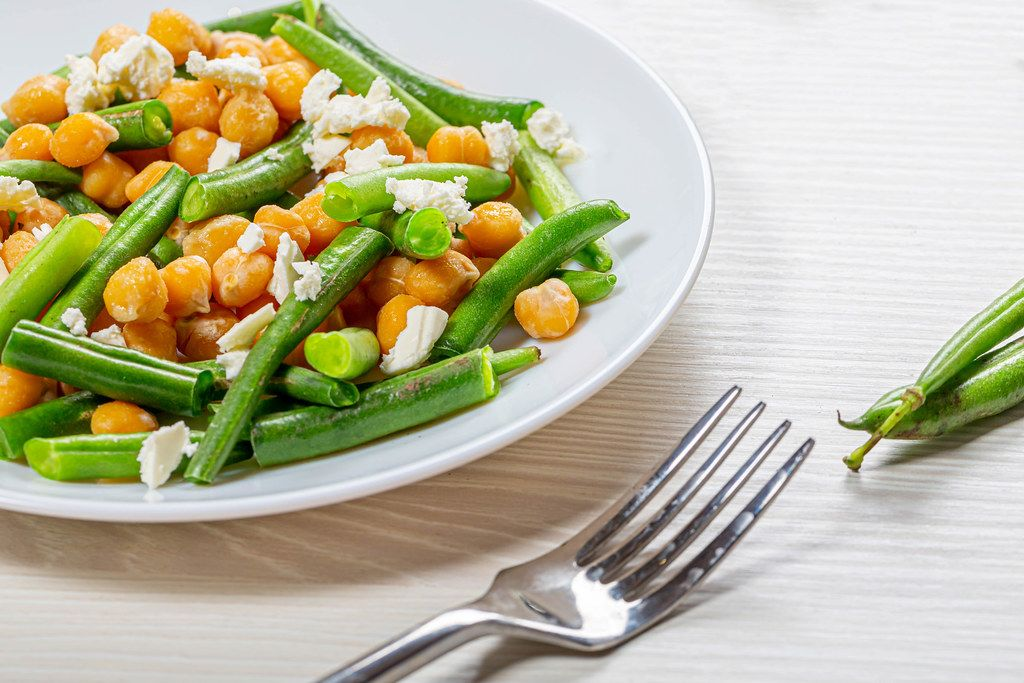 Close up chickpeas with asparagus beans and feta cheese (Flip 2019)
