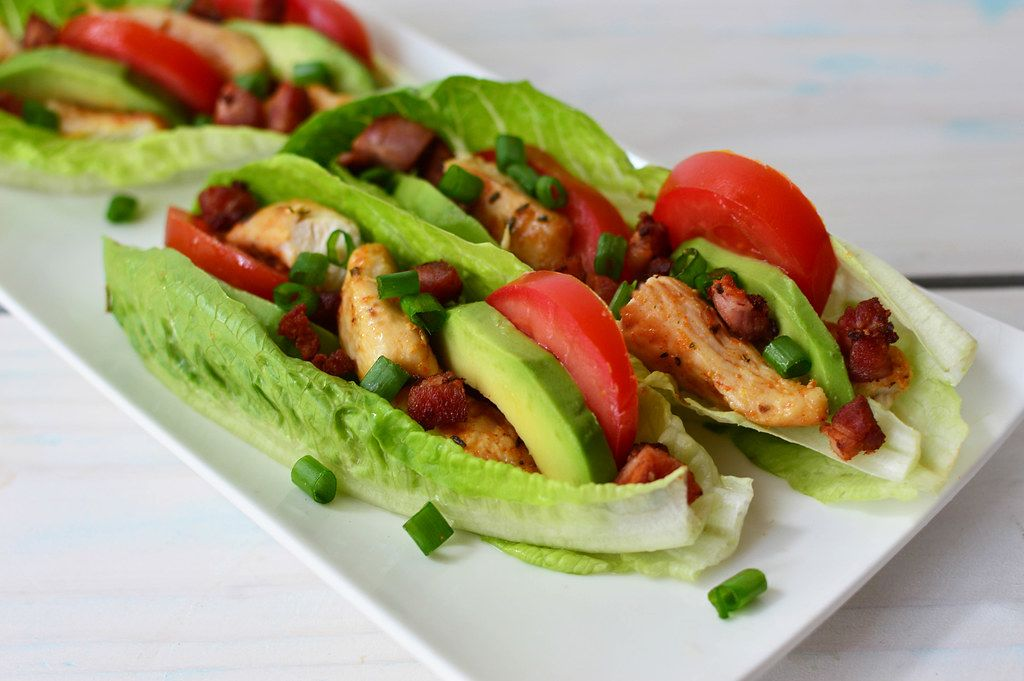 Close Up Food Photo of BLAT Wraps with Buffalo Chicken on a White Plate