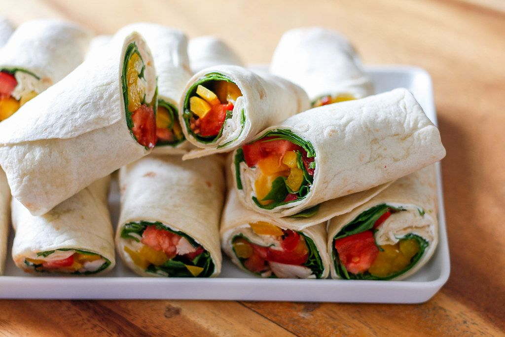 Close Up Food Photo of Vegetable and Chicken Wraps on Wooden Table