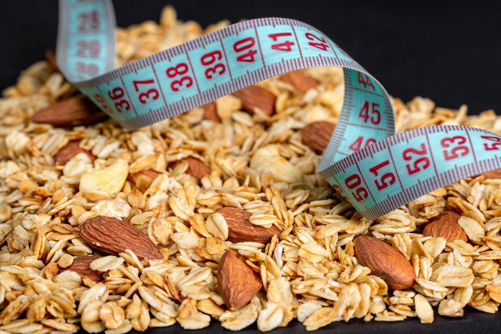 Close-up, measuring tape on oatmeal