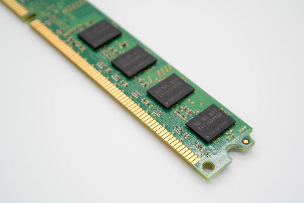 Close-up of a DDR RAM memory module on white background