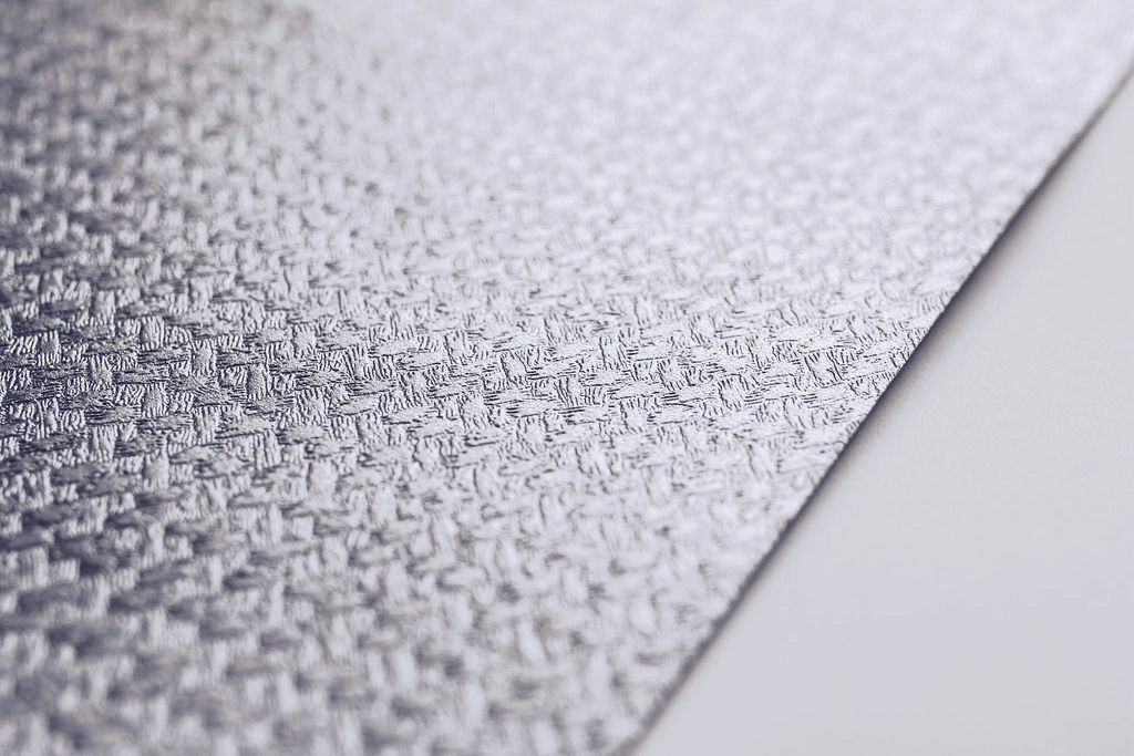 Close up of a paper texture. Silver decorative paper.