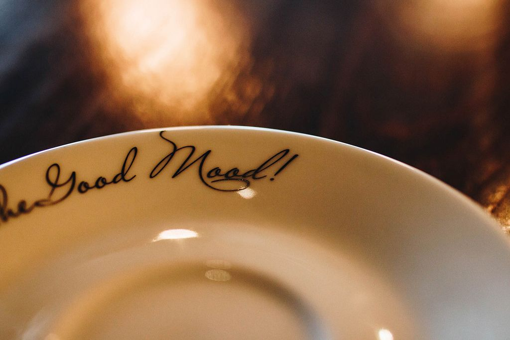 Close up of a plate with text. Good mood .