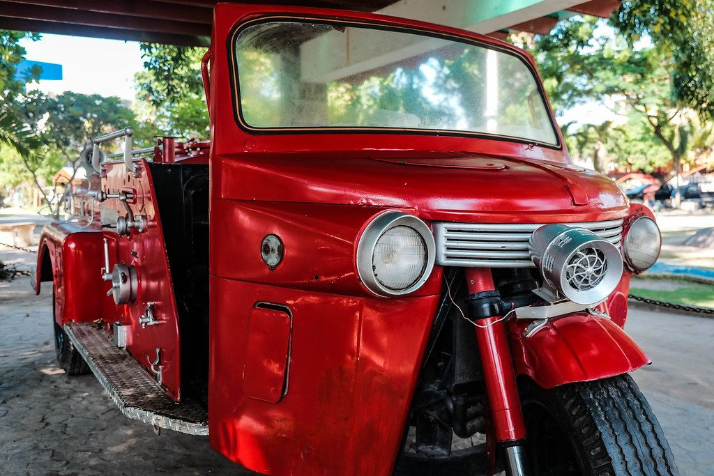 Close up of a red trike that served as a fire department vehicle